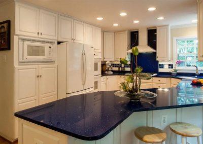 Kitchen with dark blue countertop