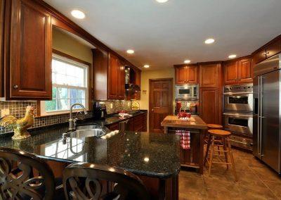 Kitchen with dark granite countertops 2