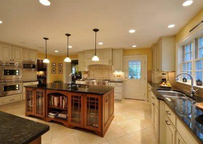 Kitchen with dark granite countertops