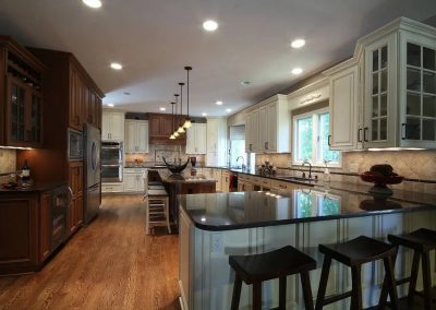 Kitchen with light cabinets and dark granite countertops 2