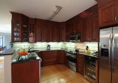 Kitchen with mahogany cabinets and dark granite countertops