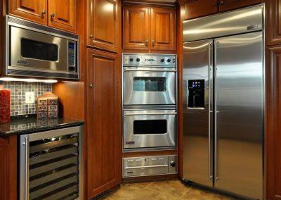 Kitchen with stainless steel appliances and wine refrigerator