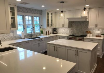 White kitchen with smooth countertops